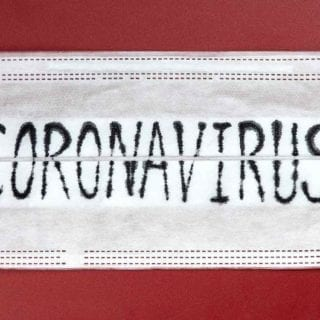 White mask with coronavirus label