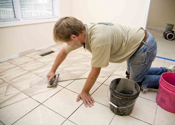 Man Working on Tiles